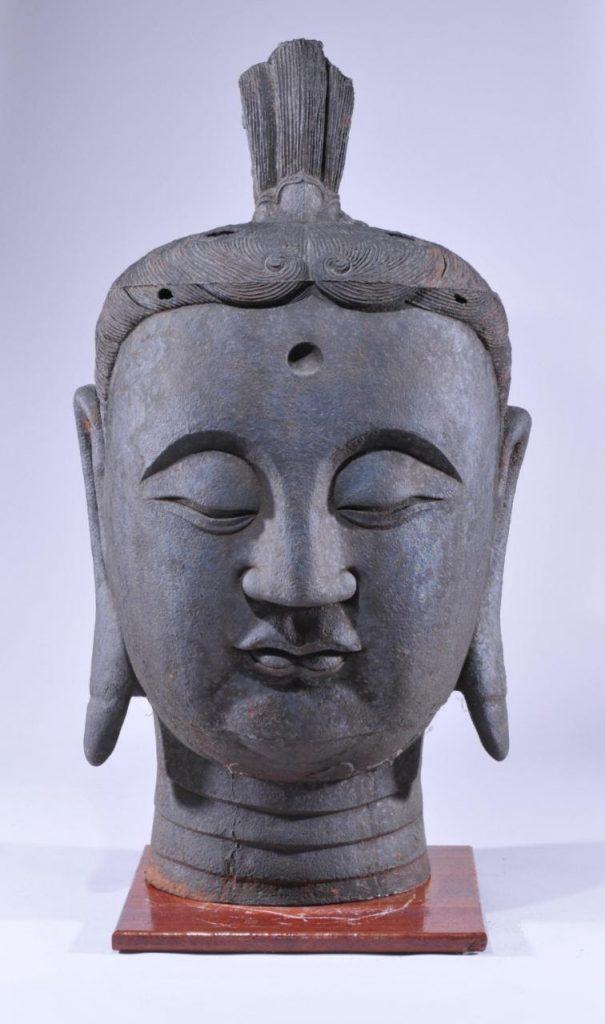 15th-century cast iron Buddha head. Photo courtesy of Tremont Auctions.
