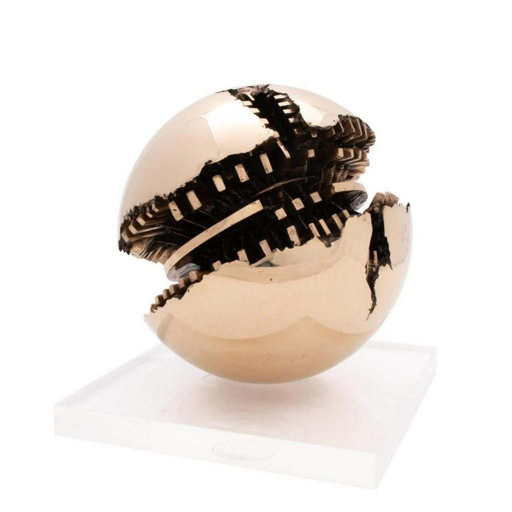 Polished bronze sculpture on a Lucite base by Arnaldo Pomodoro (Italian, b. 1926), titled Sfera, signed, titled and numbered (#2 of 6) on the base (est. $80,000-$120,000).