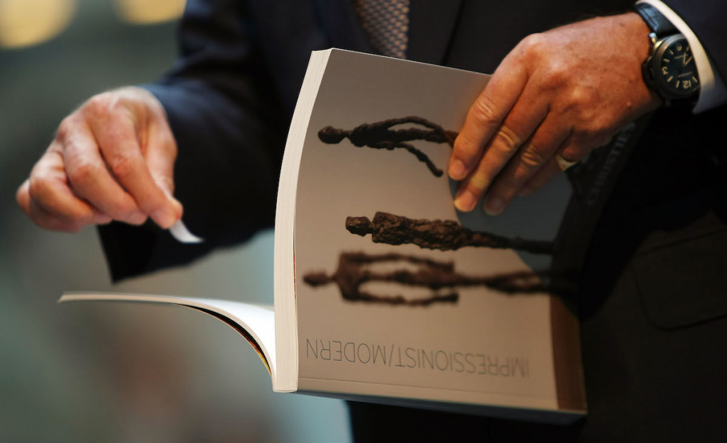 Christie's reduced production of auction catalogs and printed materials starting in 2019. Image from Mario Tama/ Getty Images.