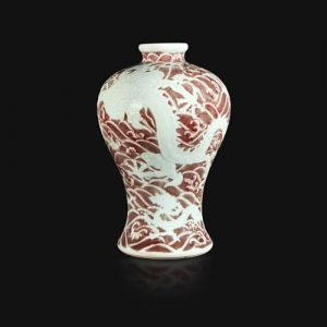 """A Chinese carved and underglaze red """"Dragons and Waves"""" vase, Meiping Yongzheng six-character mark and of the period"""