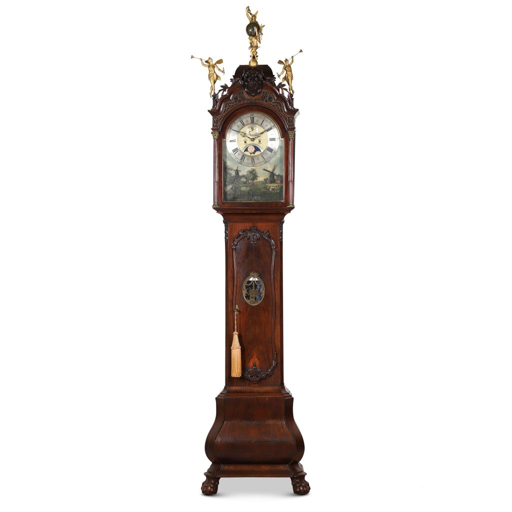 Dutch wall clock in a walnut case with barley twist columns, made in the Zaanse region of Holland near Amsterdam, 1690-1725, previously sold at Sotheby's (est. CA$6,000-$9,000).