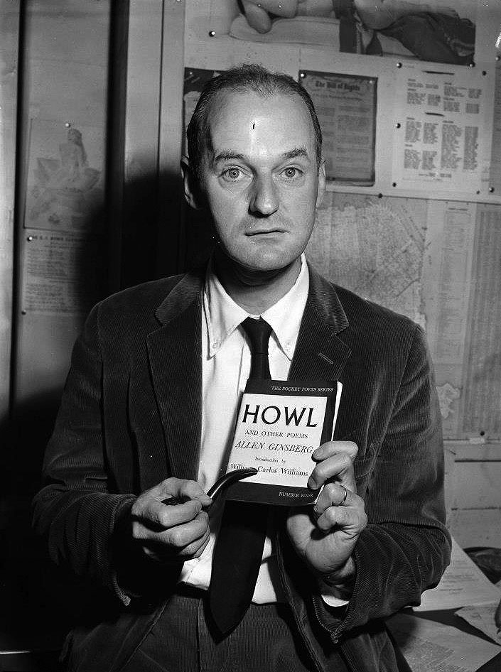 Lawrence Ferlinghetti posing with Allen Ginsberg's Howl and Other Poems. Photo from the City Lights Archive.