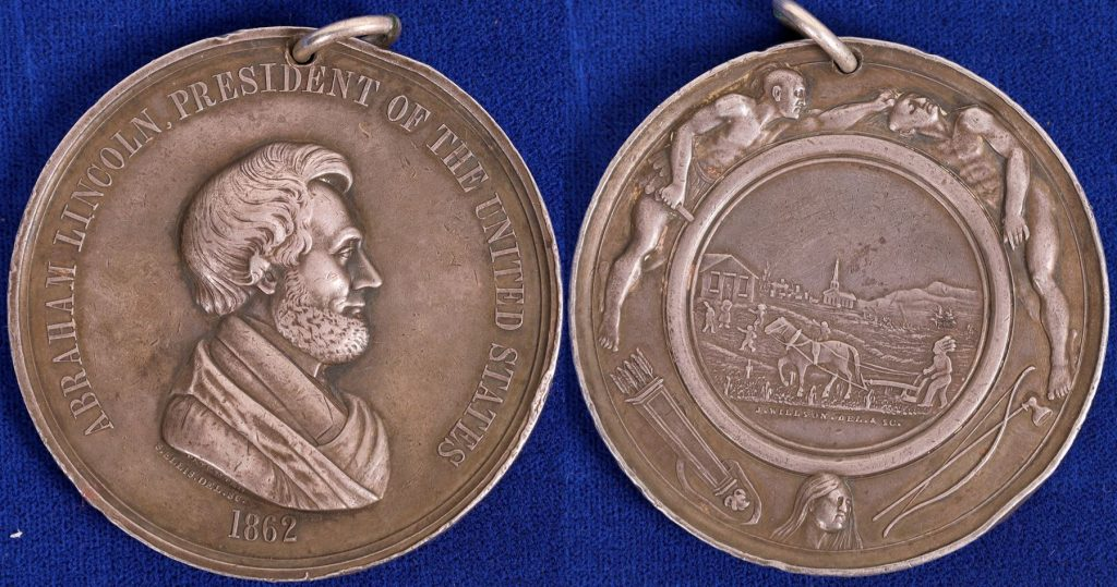 1862 Lincoln silver Peace Medal, 62.5 mm, About Uncirculated, the only Presidential peace medal issued in a year other than the inauguration date of the president ($18,750).