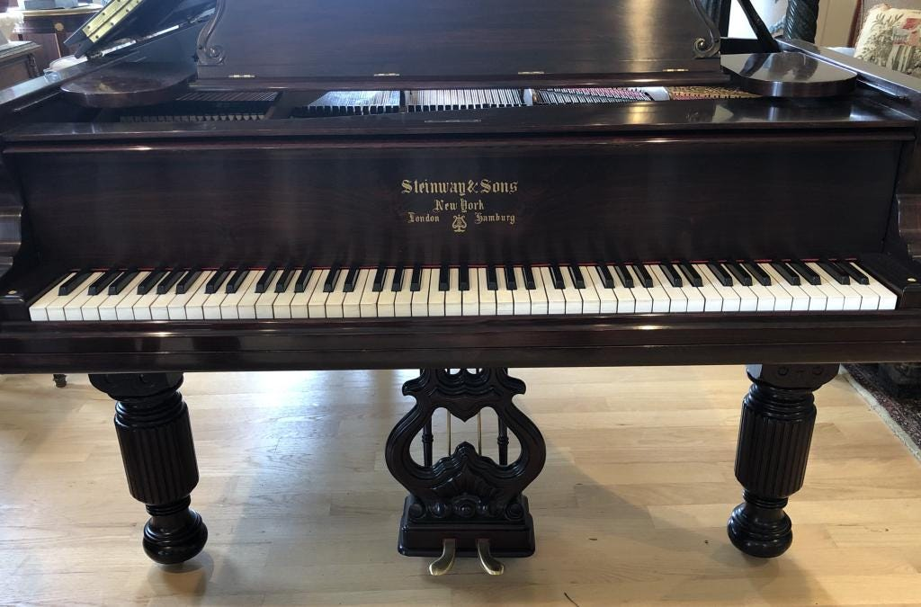 Circa-1870 Steinway rosewood grand piano, Serial No. 22700, professionally restored by Steinway approximately 20 years ago. Estimate $10,000-$15,000