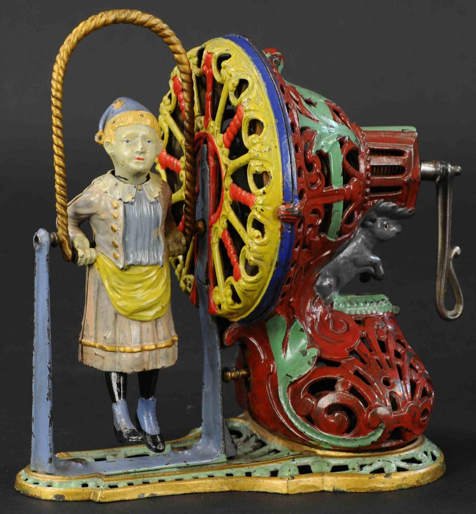 J&E Stevens (American), Girl Skipping Rope cast-iron mechanical bank. Book example depicted in Blair Whitton's 1981 reference 'Clockwork Toys.' Pristine to near-mint condition. The top lot of the sale, it sold for $156,000, a world auction record for the form.