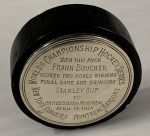 A Puck From The Stanley Cup Final Game Of 1928, Won By The New York Rangers, 2-1, Scores Big In Weiss Auctions April 14 Sale, Bringing $66,000