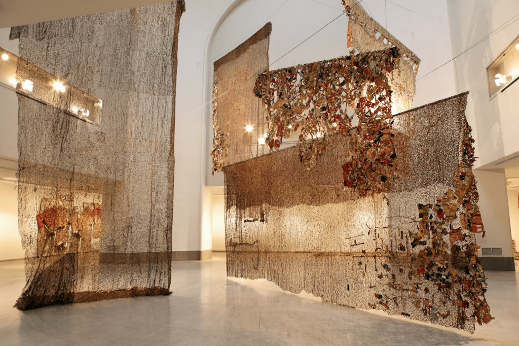 El Anatsui sculptures at the Venice Biennale in 2007. Image courtesy of Chester Higgins Jr. for The New York Times.