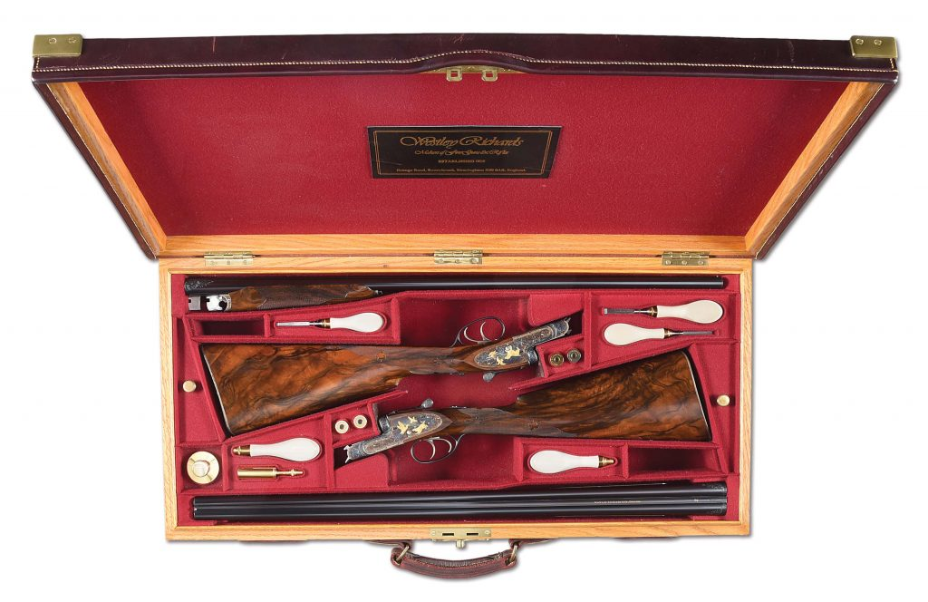 Cased pair of circa-1993 bespoke Westley Richards & Co. (England) deluxe-grade sidelock side-by-side game shotguns. Gold-inlaid and engraved by master engraver Allan Brown. One of 11 Westley Richards shotguns generously consigned by the Larry and Brenda Potterfield family with 100% of hammer proceeds directly benefiting the NRA Whittington Center. Estimate $80,000-$100,000