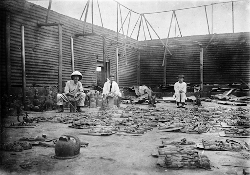 Inside the Oba of Benin's palace in 1897 after the British raid. Image via Creative Commons/ Reginald Kerrgranville.