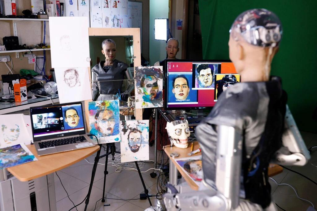 The Sophia robot working on self-portraits. Image courtesy of Tyrone Siu/Reuters.
