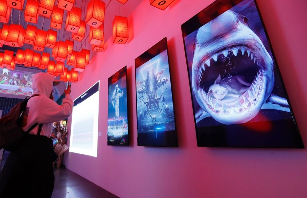 """World's first large-scale digital art exhibition (""""Virtual Niche — Have you ever seen memes in the mirror?"""") at UCCA Center for Contemporary Art in Beijing. Image courtesy of Sipa Asia/Shutterstock."""