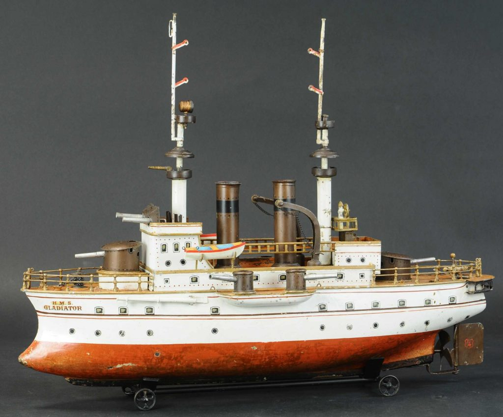 Marklin 'HMS Gladiator' clockwork battleship, 25in long, in production from 1902-1907. Wonderful proportions with exaggerated superstructure and cannons, details faithful to the real-life battleship of its day. Estimate $30,000-$50,000