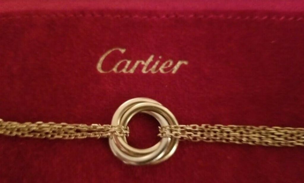 Cartier trinity tri color 18k gold 4 chain bracelet 2 rose gold, and 2 yellow gold chains attached to the charm ring from each side stamped cartier 750, and serial #