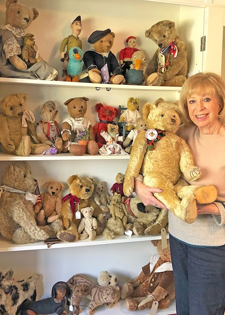 Sue Pearson and her hug of teddy bears. Image from Special Auction Services.