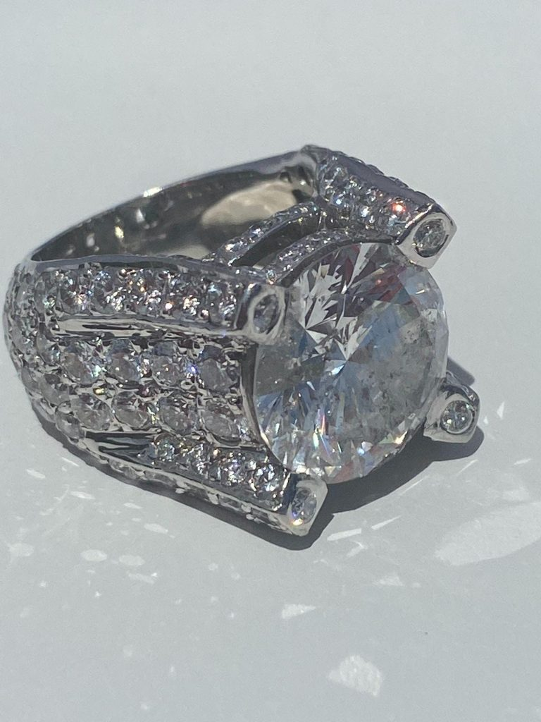 Spectacular custom-designed platinum ring with certified 10.22-carat center diamond, F color, surrounded by another 8.5 carats of diamonds. EGL certificate. Provenance: Estate of Kelli I. Martin. Estimate $100,000-$200,000