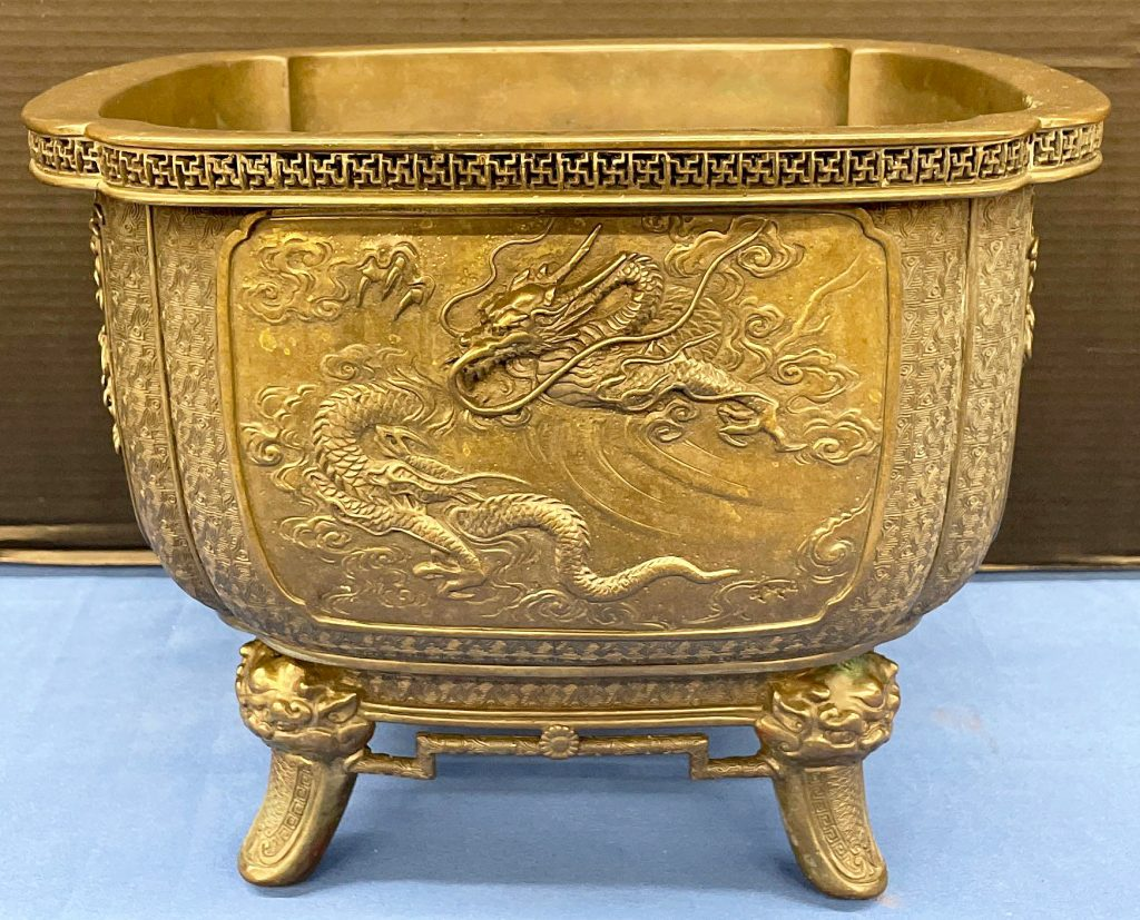 Square, Japanese bronze planter decorated in relief with a dragon, turtle, phoenix, and lion. Estimate: $300-$500.