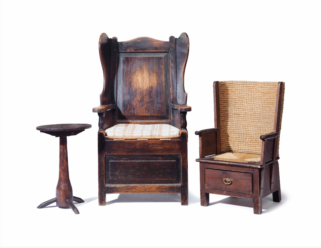 An oak and fruitwood side table, an English oak wingback chair, and a Scottish Orkney Island child's chair. Image from Christie's.