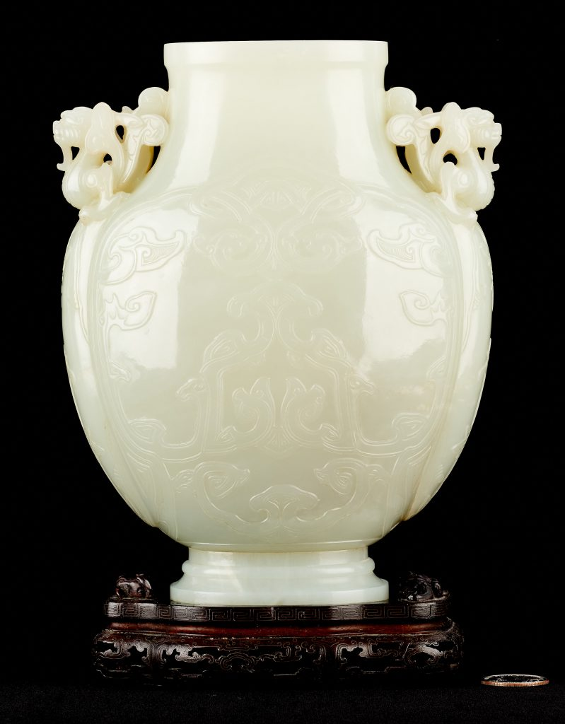 A Qing white jade vase, associated with the Kangxi/Yongzheng period with archaistic straps in imitation of archaic bronze vessels of the Western Zhou period