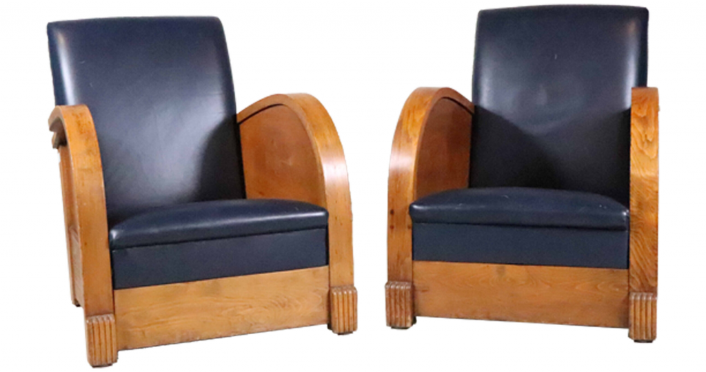 Pair of English early 20th century Art Deco blue-leather walnut club chairs, previously owned by the German television personality Alfred Biolek. Distress to leather. Estimate: $1,000-$2,000.
