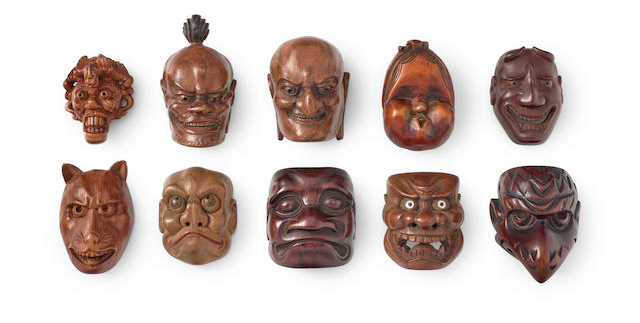 A group of ten wood mask netsuke. Image from Bonhams.