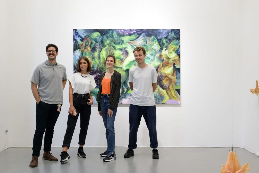Elisa Carollo (second from left) and artists in front of an artwork included in Regarding Venice at Galleria Poggiali in Milan. Image by Michele Alberto Sereni.