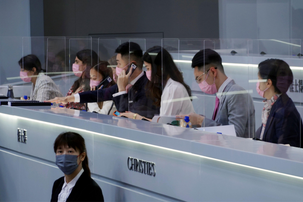 Phone bidders at Christie's Hong Kong. Image from Reuters/Alamy Stock Photo.