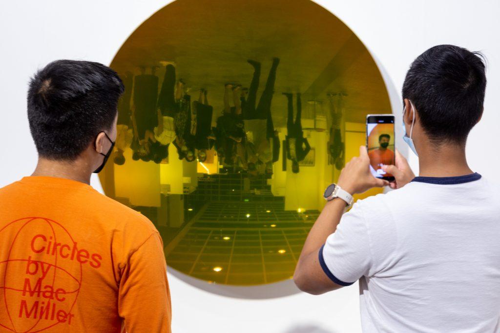 Visitors at Kamel Mennour's booth at Art Basel Hong Kong. Image from Art Basel.