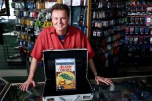 Dealer Darren Adams with his copy of Action Comics #1. Image from eBay.