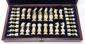 Immaculate, hand-carved Alaskan Inuit walrus ivory chess set, the pieces modeled after native fauna with exquisite calcification, purchased in San Francisco in 1903. Estimate: 3,000-$5,000.