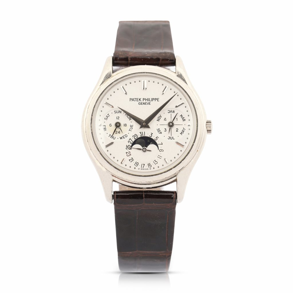 Patek Philippe Reference 3940 perpetual calendar men's watch with 18kt white gold case and clasp, originally purchased in 1999 from Tourneau in New York (CA$50,150).