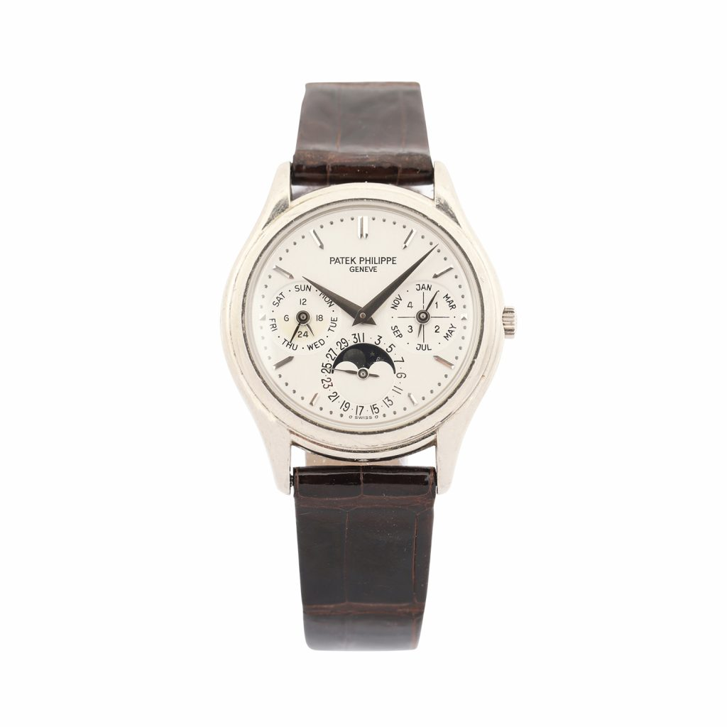 Patek Philippe Reference 3940 perpetual calendar men's watch with 18kt white gold case and clasp, originally purchased in 1999 from Tourneau (N.Y.) (est. CA$35,000-$45,000).