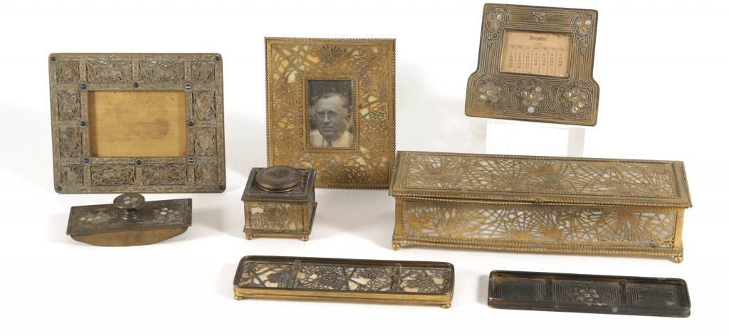A selection of Tiffany & Co. patinated gilt bronze and glass mixed pattern desk accessories (Estimate: $2,000-4,000)