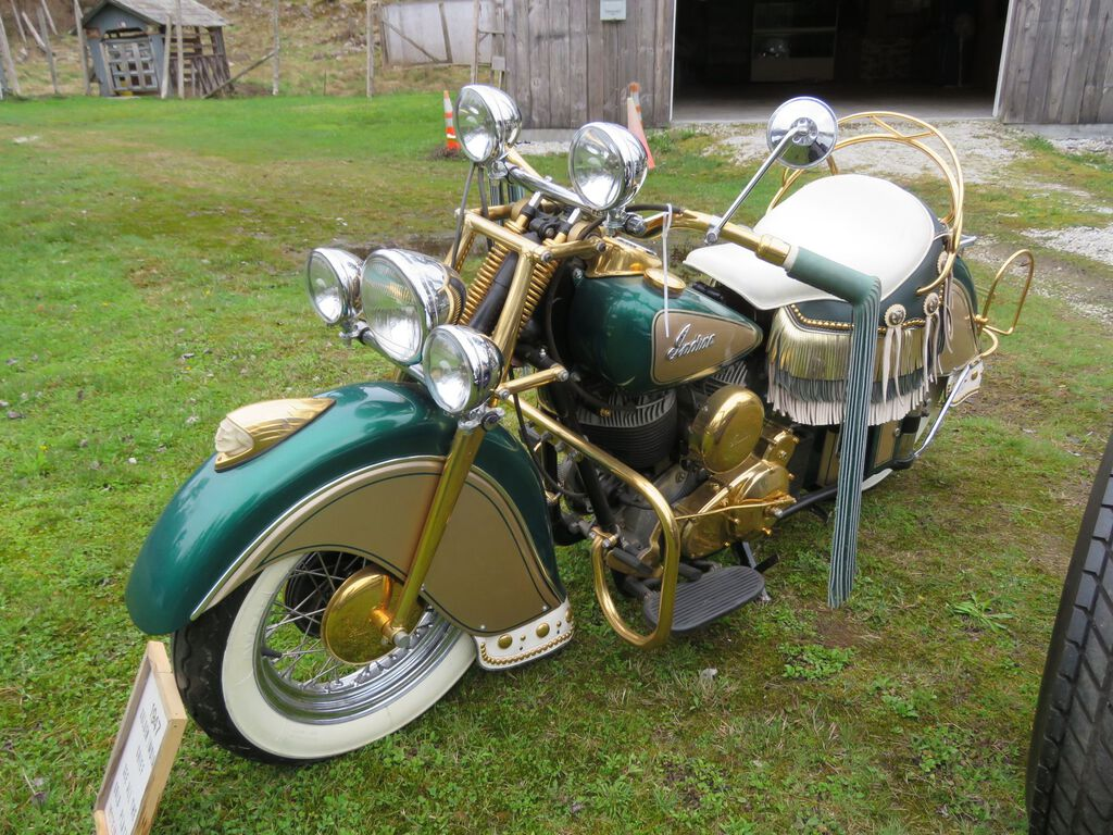 1947 Indian Chief motorcycle, an older restore that's green and gold and with all the stainless-steel parts supposedly dipped in gold (although it has not been tested for actual gold plating).