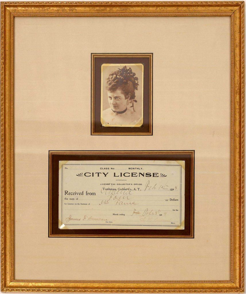 """This framed cabinet card photo of prostitute """"Amelia"""" (in classic prostitute attire) from 1898, with her business license, is expected to sell for $5,000-$10,000."""