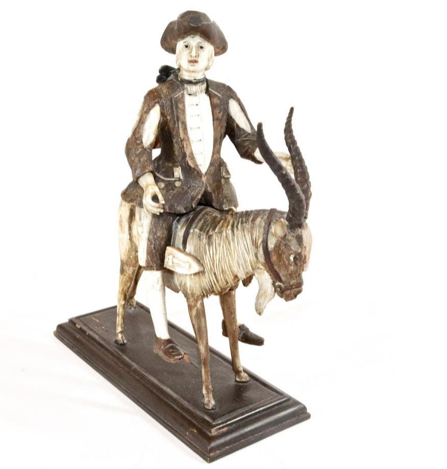 Simon Troger carving of a tailor on a goat. Image from Hartzell's Auction Gallery.