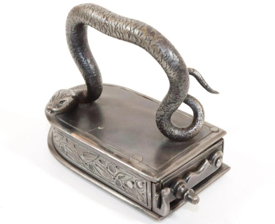 Small German box iron. Image from Hartzell's Auction Gallery.