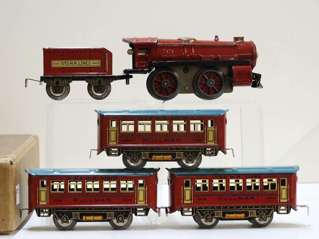 1930s Ives wind-up train set #1590 in original box. Painted sheet metal 0-4-0 steam locomotive with Ives R.R. Lines tin-litho tender and three Pullman cars. Estimate $300-$600