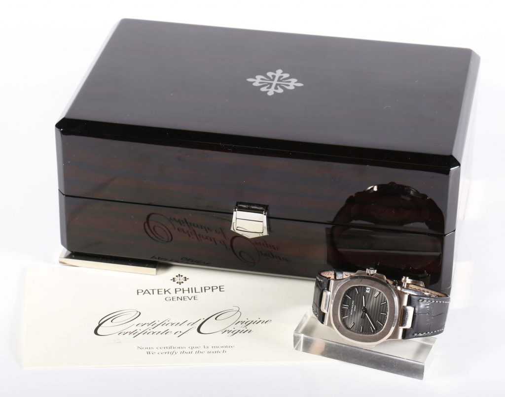 A Patek Phillipe 18k white gold Nautilus wristwatch, with the original certificate and box, circa 2009, sold for $53,750