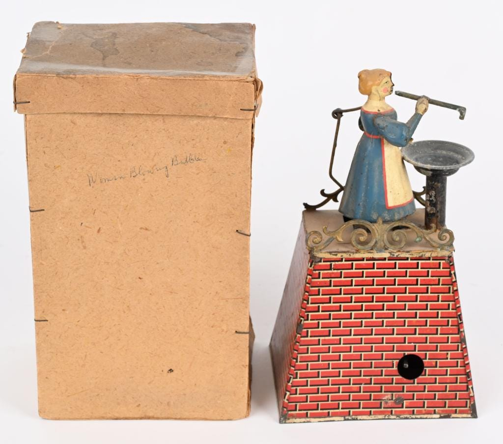 Late-19th-century German tin clockwork 'Woman Blowing Bubbles,' in working order, sold for $9,900 against an estimate of $1,000-$1,500