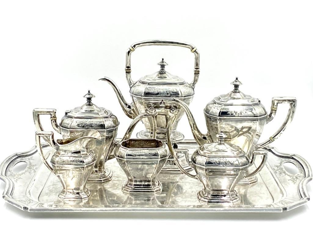 Reed and Barton sterling tea service with matching sterling silver tray, pattern 910, having a kettle on a stand, 10 ½ inches to the top of the finial, 287 oz. troy. Estimate: $4,000-$6,000.