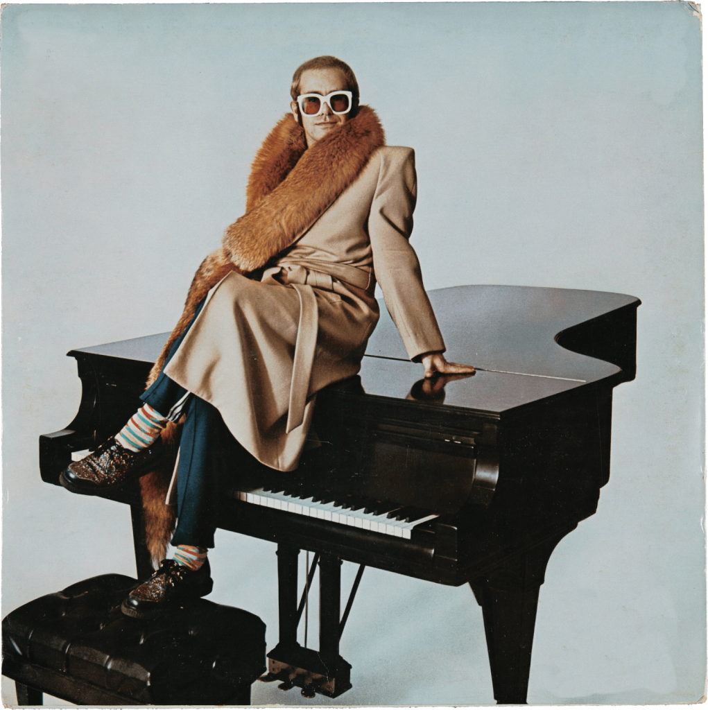 Sir Elton John posing with the Steinway piano. Image from Heritage Auctions.