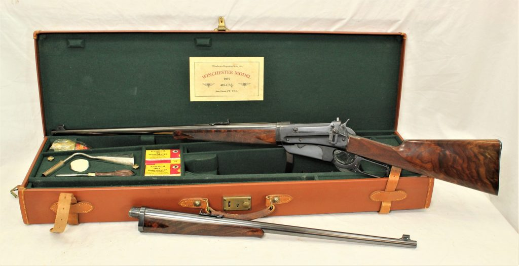 August 28, 2021 auction highlight: Winchester 1895 takedown rifle, deluxe two-barrel set (405WCF and 35WCF calibers), retains nearly 98% of its blue finish. Comes with leather case, assorted accoutrements and box of ammunition for each caliber. Image courtesy of New Frontier Shows