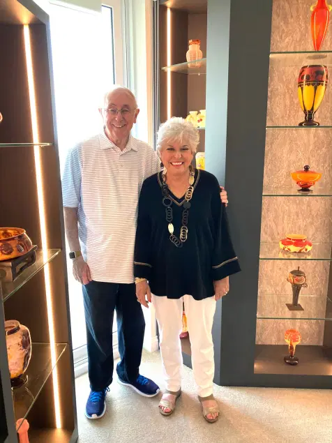 """Alan and Susan Shovers in their """"glass museum."""" Image from Miami's Community News."""