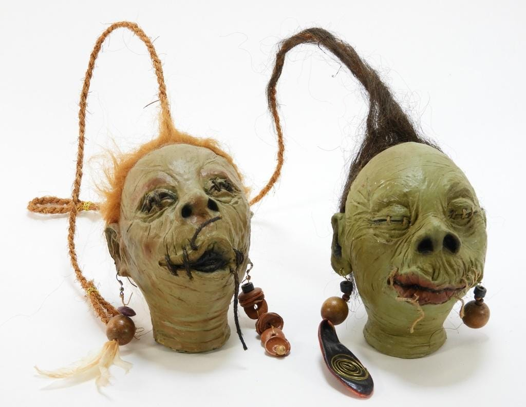 Two prototype shrunken heads from Universal Studios' Wizarding World of Harry Potter theme park, made circa 2015, to be sold as one lot. Estimate: $800-$1,200.