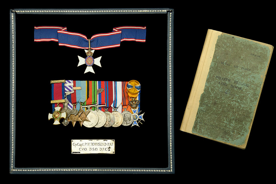The group of eleven includes a C.V.O., D.S.O., D.F.C. and Second Award Bar and will be sold with the recipient's original Flying Log Books, bound in one volume - with later annotation in his own hand - covering the entirety of his operational career.