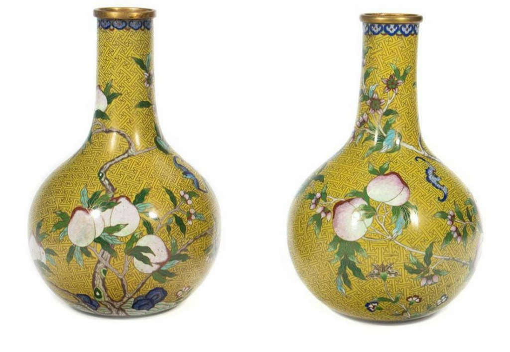 Pair Chinese Cloisonné Vases. Decorated with fruited and floral vines on yellow ground. 10 1/2in. H. Three character mark on base. Condition: One with ding to lower side. Estimate $600 - $800.