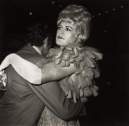 Diane Arbus, Two Men Dancing at the Drag Ball, NYC, silver print, 1970, printed 1972. Sold for $50,000, a record for the print.