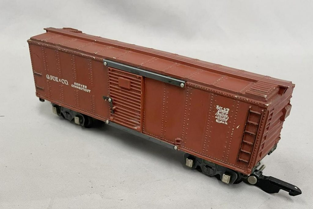 Exceedingly rare American Flyer G. Fox & Co. S gauge toy boxcar train, from a very limited production set made in 1946, Tuscan painted on white mold with nice lettering ($18,975)