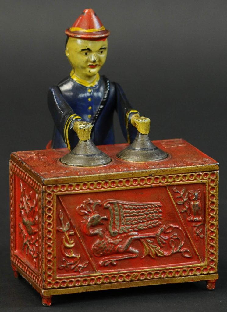 Kyser & Rex Co., Mikado cast-iron mechanical bank, red-table version, extremely rare and one of the best examples known. Provenance: The Schroeder Collection. Estimate $80,000-$120,000
