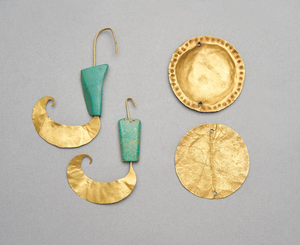 Gold leaf and turquoise earrings, and two circular gold appliqués. Earrings from the Shang dynasty. Image from Bonhams.